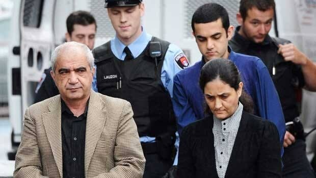 Tooba Mohammad Yahya, husband Mohammad Shafia and their son Hamed are escorted into the Frontenac County Court House in Kingston, Ont., on Oct. 20, 2011.