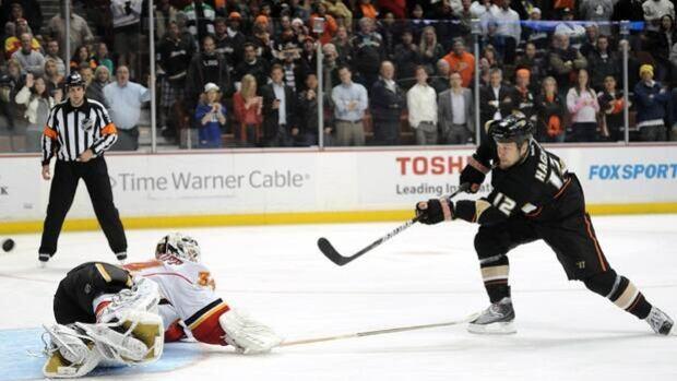 Niklas Hagman (12) scores the shootout winner on Flames netminder Miikka Kiprusoff in a 3-2 Ducks home triumph on Feb. 6.