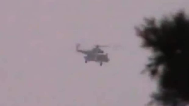 This image made from amateur video released by the Shaam News Network purports to show a Syrian military helicopter firing over a village in Daraa, Syria, last week. The Syrian government, intent on wresting back control of rebel-held areas, launched a fierce offensive in recent days to recover territories in several locations, shelling heavily populated districts and using attack helicopters over towns and cities.
