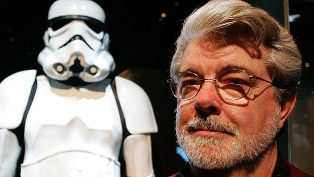 Filmmaker George Lucas poses in front of one of his iconic Stormtrooper costumes at an exhibit at the Museum of Science in Boston in 2005. Disney is buying Lucas's company Lucasfilm for $4.05 billion US.