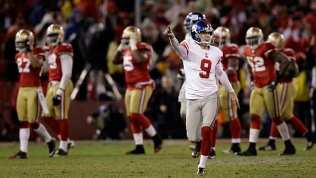 New York Giants' Lawrence Tynes reacts after kicking the game-winning field goal during overtime of the NFC Championship game against the San Francisco 49ers on Sunday in San Francisco. The Giants won 20-17 to advance to Super Bowl XLVI.