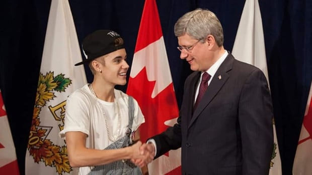 Prime Minister Stephen Harper presents Justin Bieber with a Diamond Jubilee Medal in 2012.