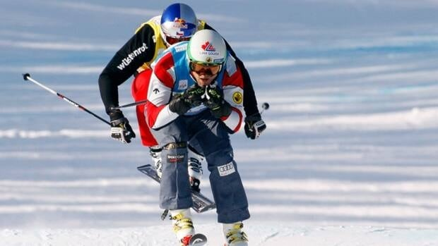 Brady Leman, from Calgary, Alta., right, leads the Czech Republic's Tomas Kraus, left, during the men's World Cup ski cross event in Nakiska, Alta., Saturday, Dec. 8, 2012.