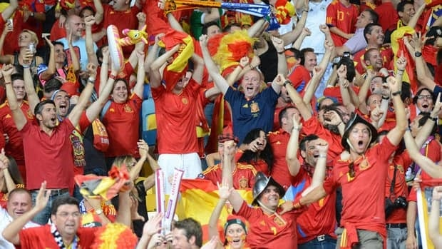 Spanish fans celebrate after a goal during the Euro 2012 final match between Spain and Italy on July 1, 2012 at the Olympic Stadium in Kiev.