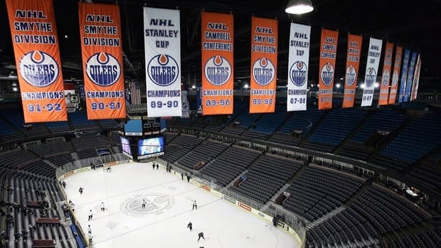 Banners from previous Edmonton Oilers championships and Stanley Cup victories hang from the rafters at the Rexall Place.