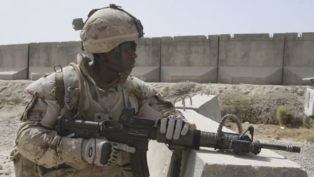 "A Canadian solider in Kandahar province south of Kabul, Afghanistan in Aug. 2009.  Maj. Christopher Lunney was hailed by a military prosecutor for his ""integrity and honour"" Wednesday even as he pleaded guilty to negligent performance of duty."