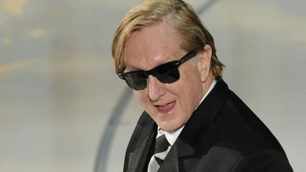 T Bone Burnett, shown at 2010 Oscar ceremony, is among the ambassadors the U.S. Recording Academy hopes can strike a deal to include liner notes with digital music.