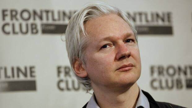 Julian Assange listens at a press conference in London on Monday, after WikiLeaks began publishing a massive trove of emails from U.S. intelligence company Stratfor.