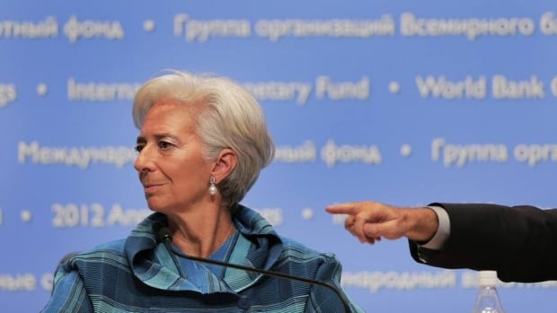 International Monetary Fund chief Christine Lagarde listens to a question during a news conference at the IMF and World Bank's annual general assembly in Tokyo.