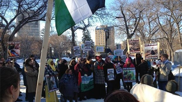 People gathered in Regina's Victoria Park Saturday afteroon to protest the violence in Gaza.