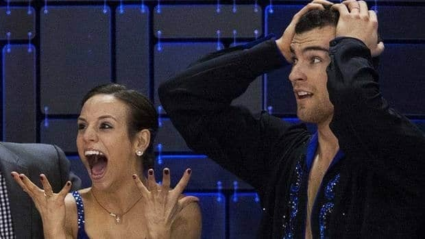 Meagan Duhamel and Eric Radford react as their score is posted after their skate to gold in the senior pair free competition.