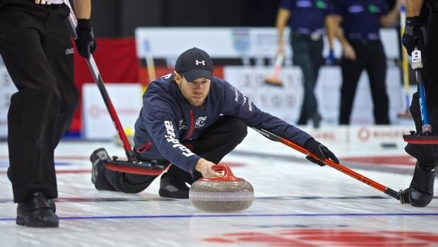 B.C. skip Jim Cotter delivers a stone during his semifinal match on Sunday at the Rogers Masters in Brantford, Ont.