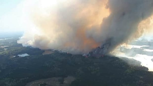 Calmer winds are making things easier for fire crews battling a forest fire near Timmins, Ont.