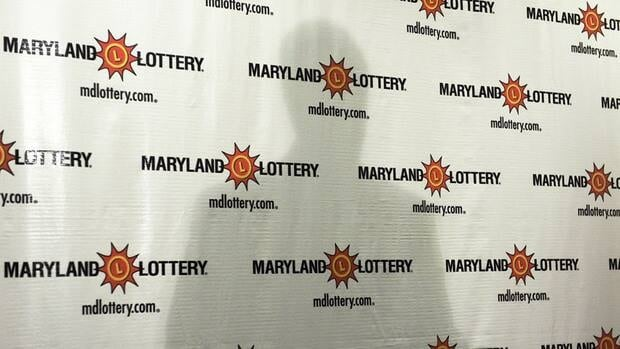 Maryland Lottery Director Stephen Martino casts a shadow as he addresses reporters. A $218M lotto winner in Maryland has decided to stay anonymous.