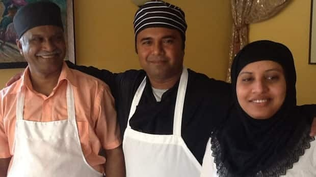 Samsu Mia, left, with his son Mostofa and daughter Meenara Akter, at their new restaurant.