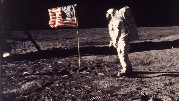 This July 20, 1969, file photo shows astronaut Edwin E. Buzz Aldrin Jr. standing beside the U.S. flag deployed on the moon during the Apollo 11 mission. NASA has been asked to verify moon rocks found among the possessions of a deceased casino mogul.