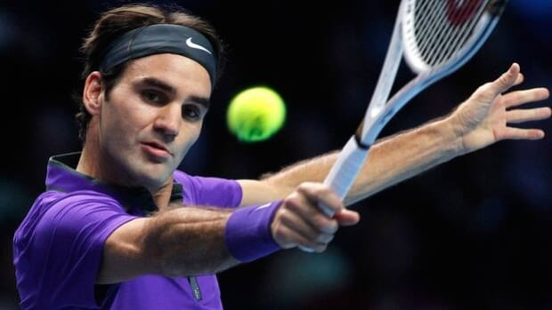 Roger Federer hits a backhand in Monday's 7-6, 7-5 loss to Novak Djokovic in the ATP finals.