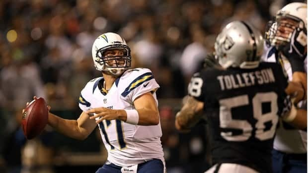 San Diego Chargers quarterback Philip Rivers drops back to pass against the Oakland Raiders during their season opener Monday.