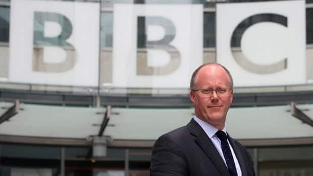 Director General of the BBC George Entwistle poses for media outside new Broadcasting House in Central London Wednesday July 4, 2012.