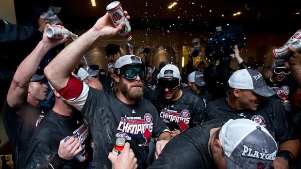Washington Nationals right fielder Jayson Werth, centre, celebrates with teammates after clinching the NL East division on Monday. The Atlanta Braves lost to the Pittsburgh Pirates, giving the Nationals the title despite a 2-0 loss to the Philadelphia Phillies.