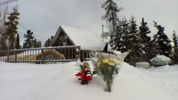 Flowers were laid at the house in Whitehorse's Porter Creek neighbourhood in  January 2012 where five people died, including two school-aged children.