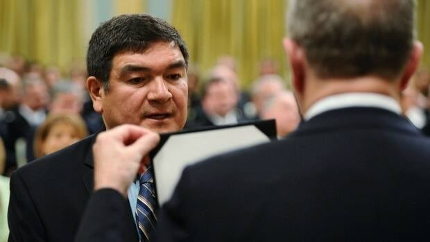Newly-appointed Minister of Intergovernmental Affairs Peter Penashue is sworn in at Rideau Hall in Ottawa on Wednesday, May 18, 2011.