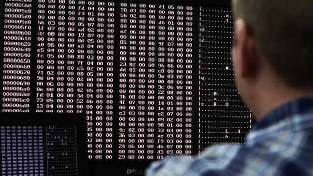 An analyst looks at code in the malware lab of a cybersecurity defence lab at the Idaho National Laboratory. Computer viruses, such as the recently identified Flame worm, are being increasingly used as tools of state espionage.