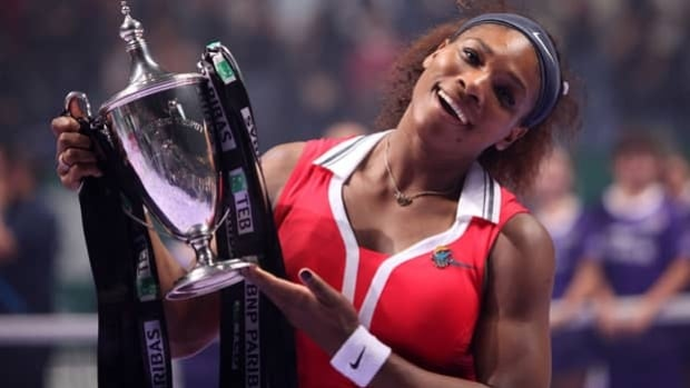 Serena Williams hoists a trophy upon winning the WTA Championships in Istanbul on Oct. 28.