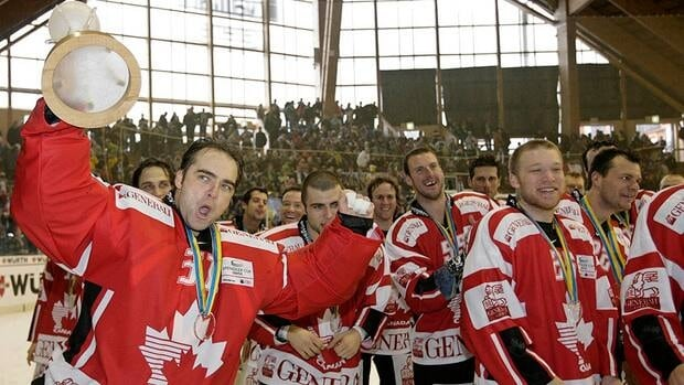 Team Canada goalie Curtis Joseph, left, is seen here with the Spengler Cup trophy the last time Canada won the tournament in Davos, Switzerland on Monday, Dec. 31, 2007. With the NHL lockout extended, Canada could potentially be sending its best squad since that year.