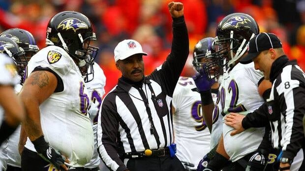 Referee Mike Carey, centre, is one of the officials locked out by the NFL.