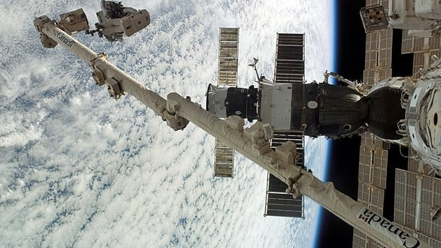 Canadian astronaut Dave Williams is anchored to the foot restraint on the Canadarm2 as construction and maintenance continue on the International Space Station on Aug. 13, 2007.