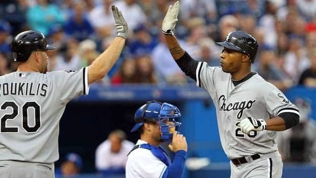 Kevin Youkilis, left, and Dewayne Wise of the Chicago White Sox celebrate Wise's home run against the Toronto Blue Jays on Thursday.