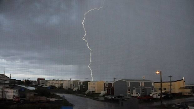 A large bolt of lightning strikes some homes in Inuvik, N.W.T., on Sunday, July 8, 2012. The lightning took out power to some homes and caused problems for radio and television.
