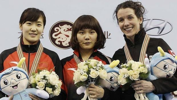 Marie-Eve Drolet of Canada, right, clocked two minutes 23.474 seconds in the women's 1,500-metre race at the world short-track speedskating championships, finishing behind winner Liu Qiuhong, left, and her compatriot Li Jianrou.