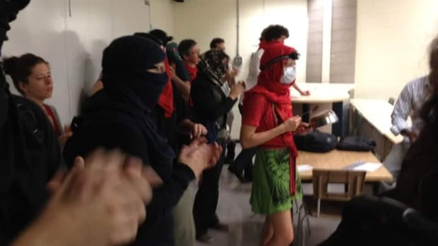 Students demonstrate inside a classroom at the University of Quebec in Montreal on Monday, with anti-protest provisions of Quebec's Law 12 hanging over their heads.
