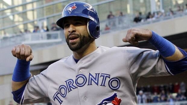 Toronto Blue Jays' Jose Bautista celebrates his solo home run against the Minnesota Twins on Saturday night.