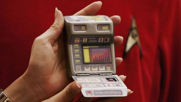 A Christie's employee holds up a tricorder prop before a 2006 Star Trek auction. The X Prize Foundation and tech firm Qualcomm have launched a contest seeking a real-life version of the sci-fi medical device.