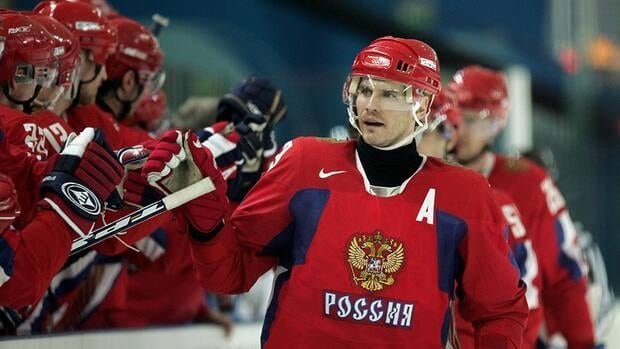 Alexei Yashin of Russia is seen here celebrating with his teammates after Russia scored during a men's ice hockey match at the Turin 2006 Winter Olympic Games. Yashin will now lead the Russian women's team into the Sochi Olympics.