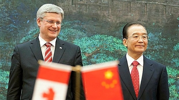 Prime Minister Stephen Harper and Chinese Premier Wen Jaibao preside over Wednesday's official signing ceremony in Beijing.