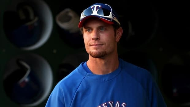 Josh Hamilton of the Texas Rangers stands in the dugout before their game against the Oakland Athletics at O.co Coliseum on October 2, 2012 in Oakland, California.