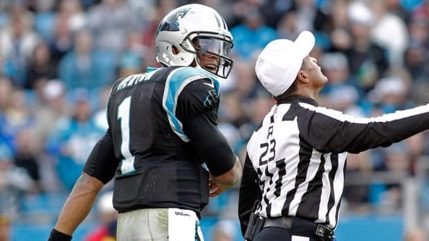 Referee Jerome Boger calls an unsportsmanlike-conduct penalty on Carolina Panthers quarterback Cam Newton against the Oakland Raiders on Sunday.