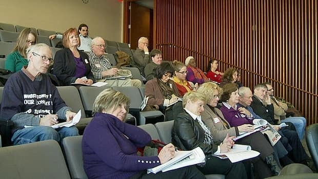 Community stakeholders attend a meeting on Friday at Hamilton City Hall. The topic of discussion is how to respond to provincial cuts to services for low-income Ontarians.