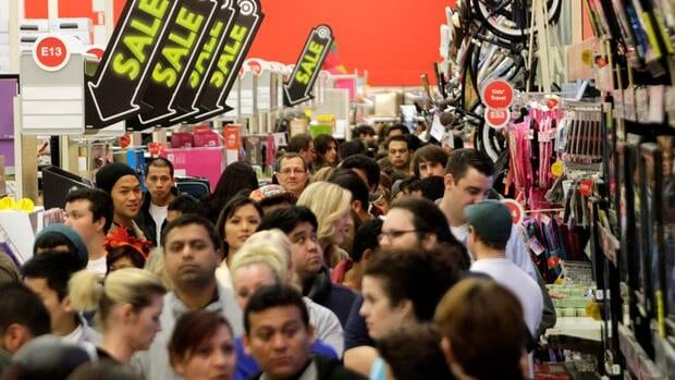 A crowd of shoppers browse at Target on the Thanksgiving Day holiday.
