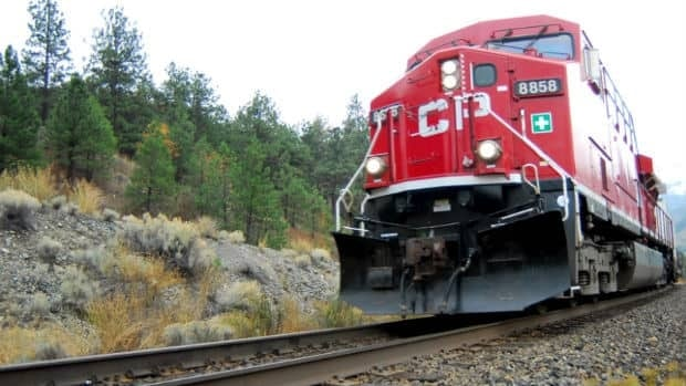 RCMP say an Alberta man picked up his beer and walked away without a scratch after being run over by 26 Canadian Pacific Railway cars on Sunday.