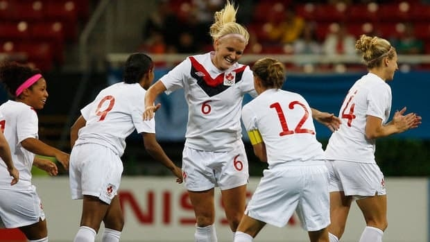 Canada's Kaylyn Kyle celebrates her goal against Colombia with teammate Christine Sinclair (12) during the Pan American Games semifinals in Guadalajara, Mexico, in October. Kyle says the team is excited for the chance to play at home.