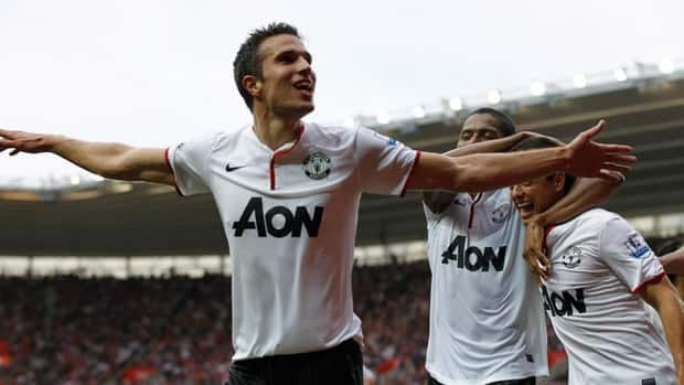 Manchester United's Robin Van Persie, left, celebrates his third goal against Southampton with teammates at St Mary's stadium, Southampton, England, on Sunday.