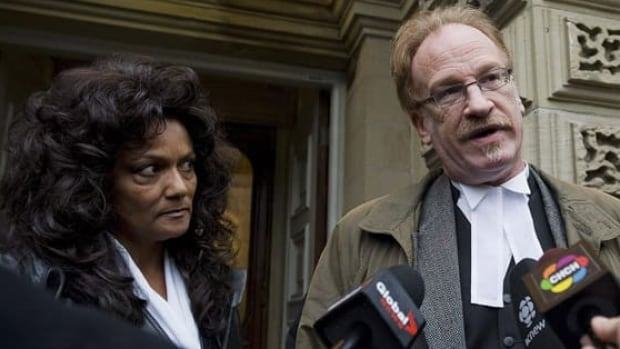 Dominatrix Terri-Jean Bedford and her lawyer Alan Young talk to media outside an Ontario Court of Appeal in Toronto, Monday, Nov. 22, 2010. (Aaron Vincent Elkaim/Canadian Press)