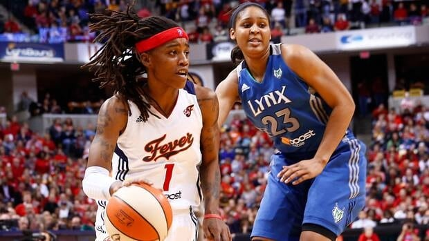 Indiana Fever's Shavonte Zellous dribbles to the hoop as Maya Moore of the Minnesota Lynx defends her on Friday night.