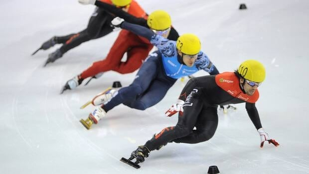Charles Hamelin of Canada, at right,  was victorious in the men's 500 metre event  in Shanghai on Sunday for his forst gold medal of the season.