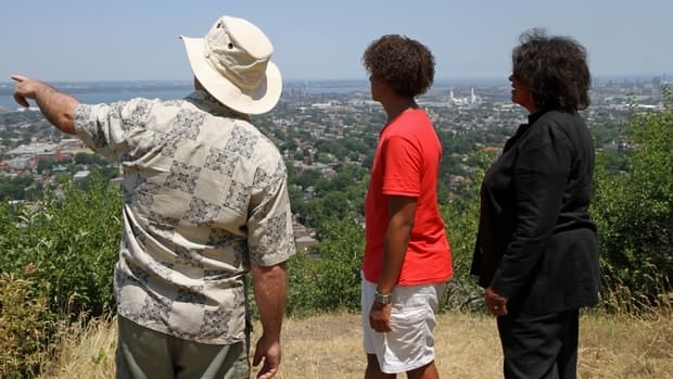 "Members of the Holland family explore ""Little Africa,"" the area on top of Hamilton Mountain where most fugitive slaves first settled."